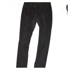 Black fashion nova jeans with rips ! Flattering!